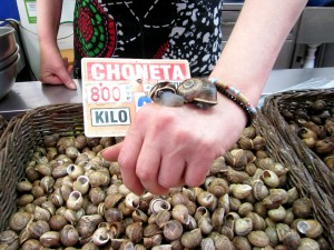 caracoles en mano